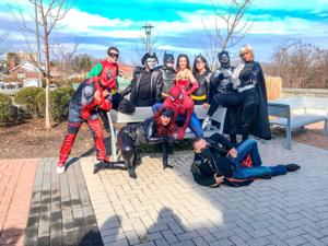 Superheroes treat the kids at St. Mary's 3