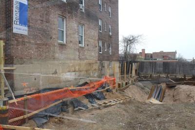 Shoring work starts at cracking Rego building 1