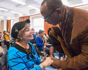 <p>Councilman Daneek Miller, a former MTA bus operator, speaks with a resident at a January forum on senior citizens and transportation issues in Queens. Information gleaned will be put into a report that will be presented this coming October.</p>