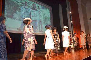 <p>Students from the Edge School of the Arts pay tribute to the Rev. Martin Luther King Jr. at the Jamaica Performing Arts Center on Monday, commemorating what would have been the slain civil rights leader's 91st birthday.</p>