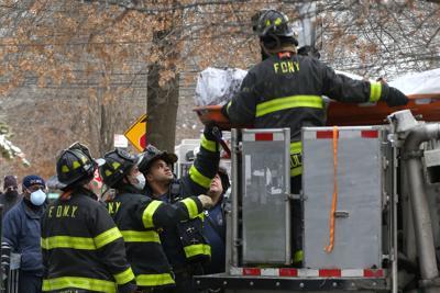 Troubled building burns, killing three