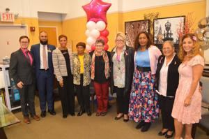 <p>Robert Fox, senior manager of Community Development for the American Cancer Society Northeast Region, left, Raymour &amp; Flanigan store manager Farrukh Raghib, Councilwoman Adrienne Adams and honorees Fran Hicks, Arlene Fiorella, Debbie Rooney, Merlina Marcellin, Allison Rogers and Gina Vasquez mark Breast Cancer Awareness Month.</p>