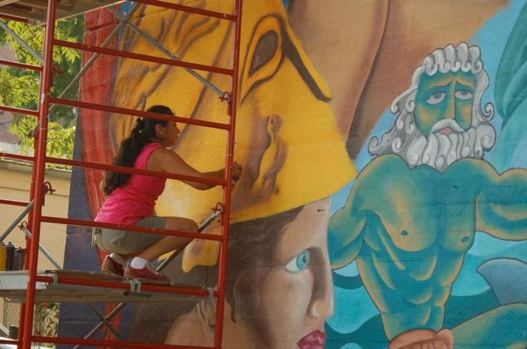 Muralist covers illegal billboards 2