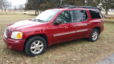 03' GMC Envoy XL, 4.2, 4X4, red, tan leather, 3rd