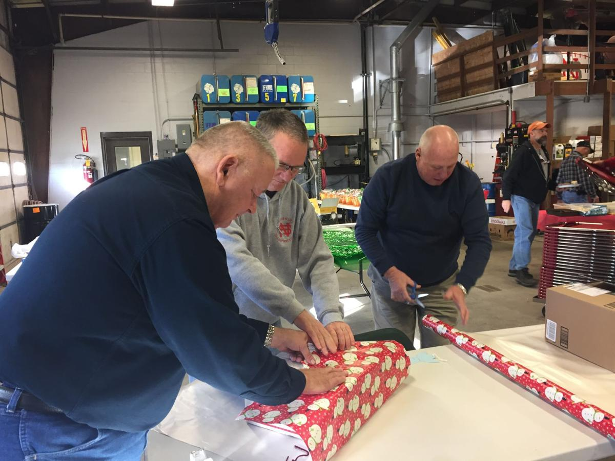 Bus drivers wrap gifts