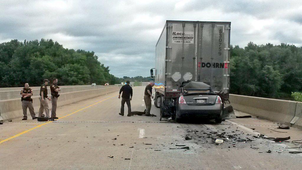Centennial Expressway shut down after car-semi accident | Traffic
