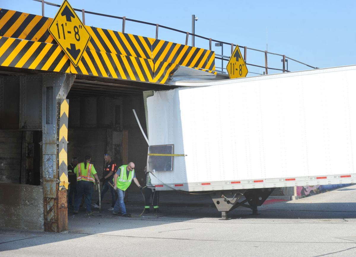 Truck-eating bridge snacks on semitrailer