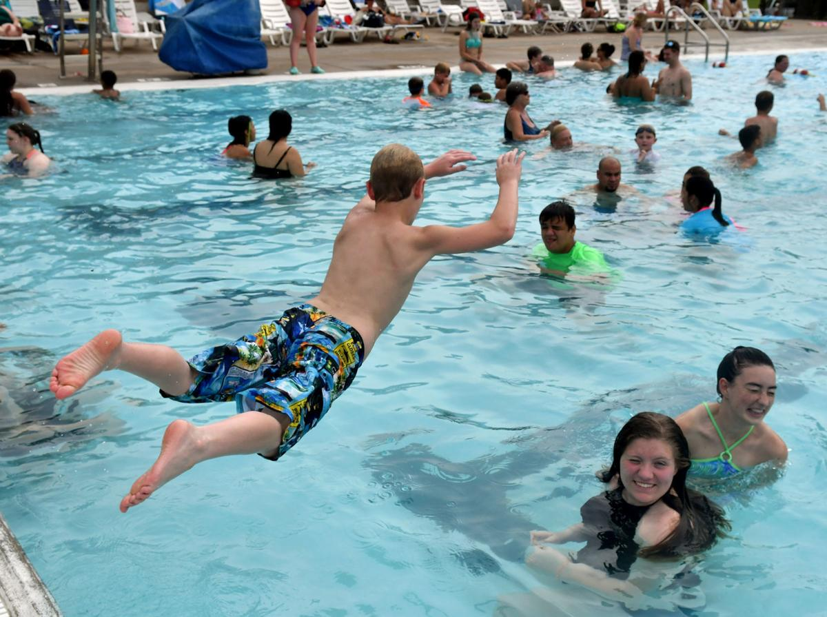 People cooling off on a hot day at Splash Landing in Bettendorf.