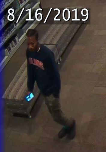 Man sought for exposing himself to library patron