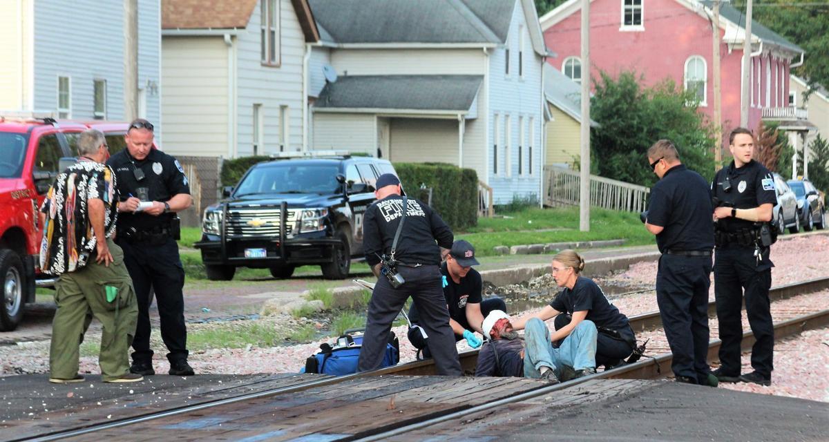 Man dragged  by train
