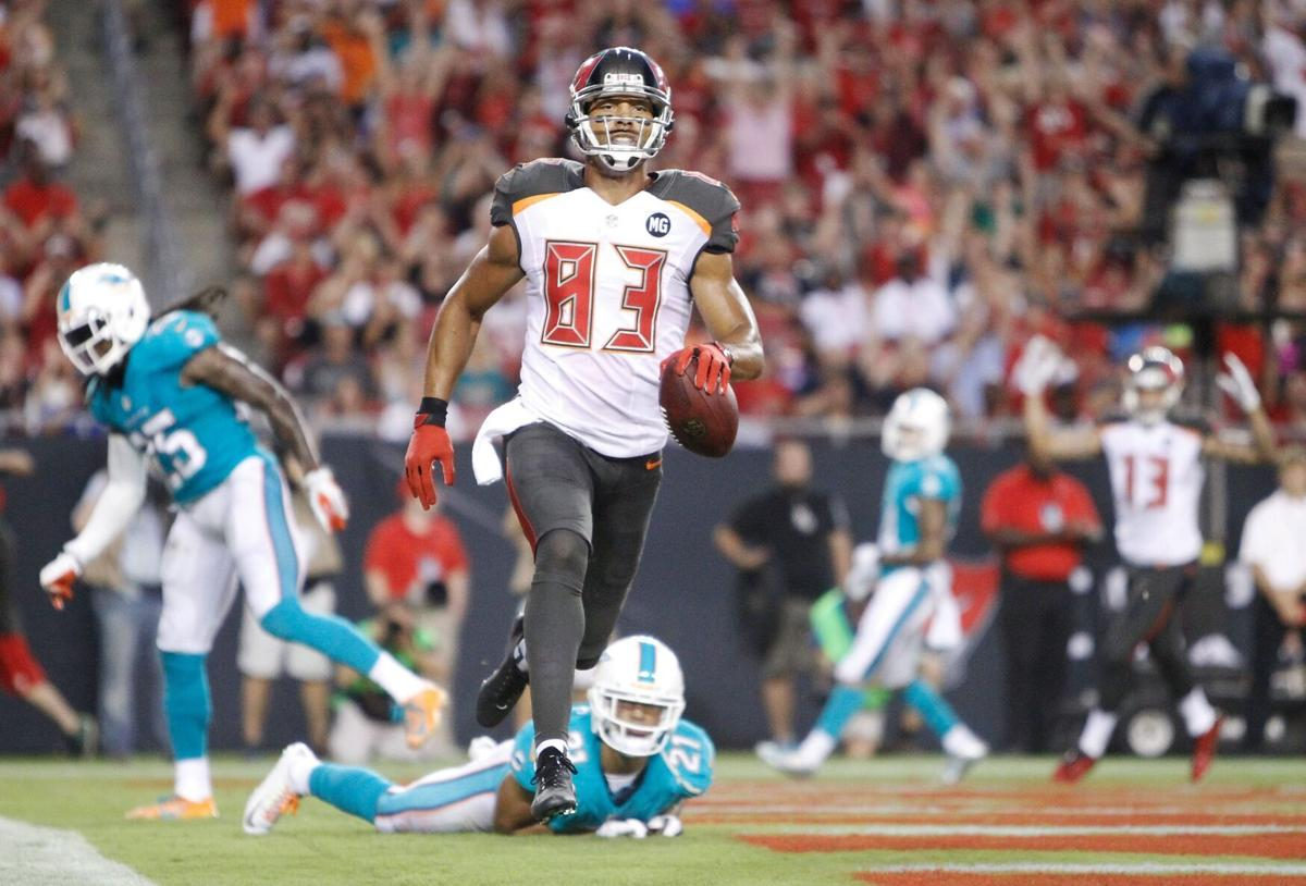 Tampa Bay Buccaneers wide receiver Vincent Jackson scores a 7- yard touchdown on a pass from Josh McCown against the Miami Dolphins at Raymond James Stadium in Tampa, Fla., on Saturday, August 16, 2014.