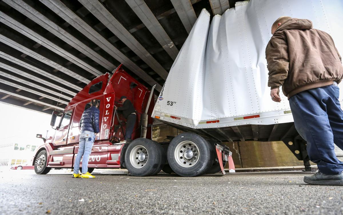 Harrison Street bridge claims another truck