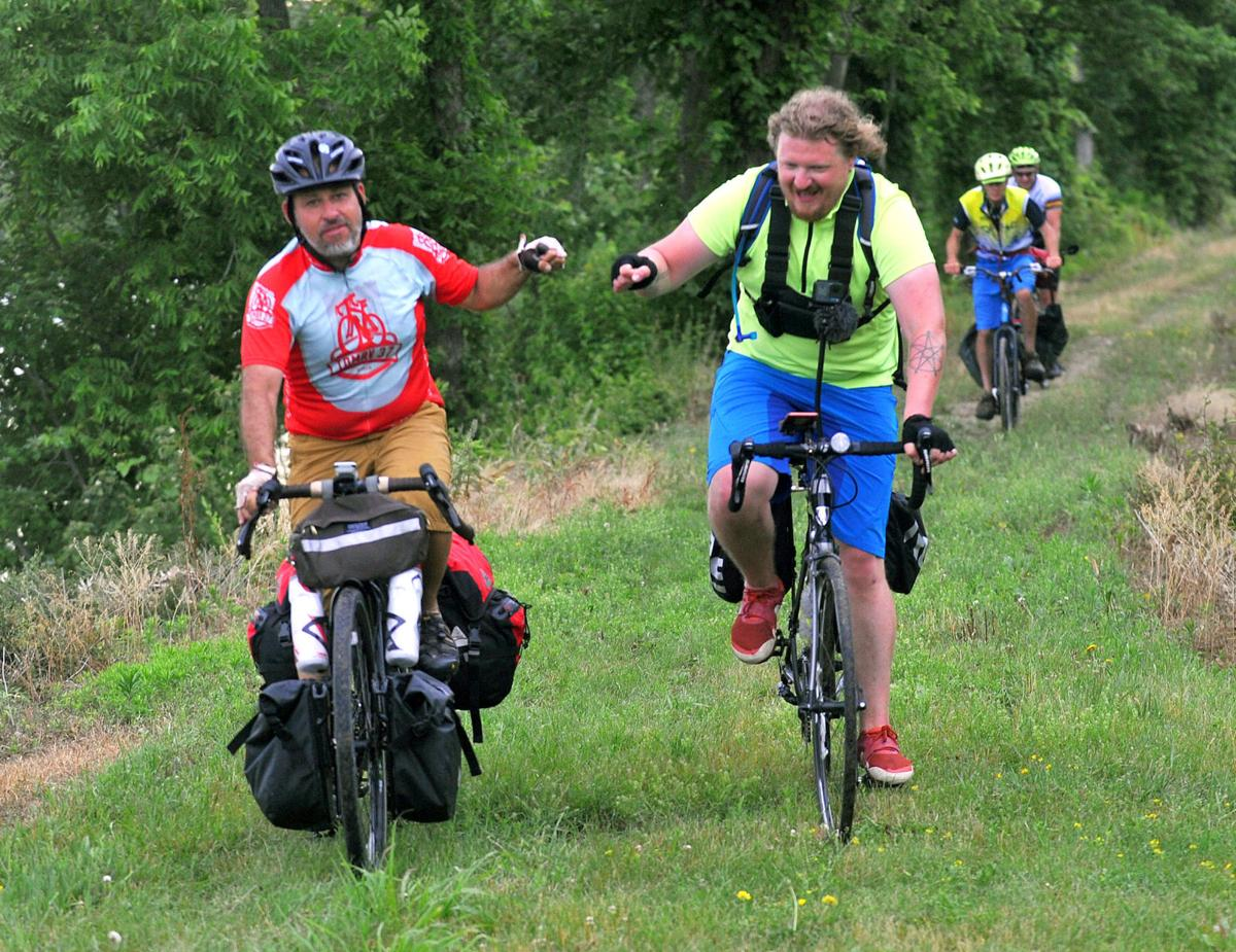 NIU faculty member Dan Libman and WNIJ producer Carl Nelson ride the 320-mile Rock River Trail by bicycle.