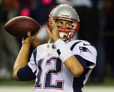 New England Patriots quarterback Tom Brady warms up before a 2013 game against the Atlanta Falcons in Atlanta.