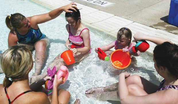 Special needs children learn to swim trust local news for United township high school swimming pool