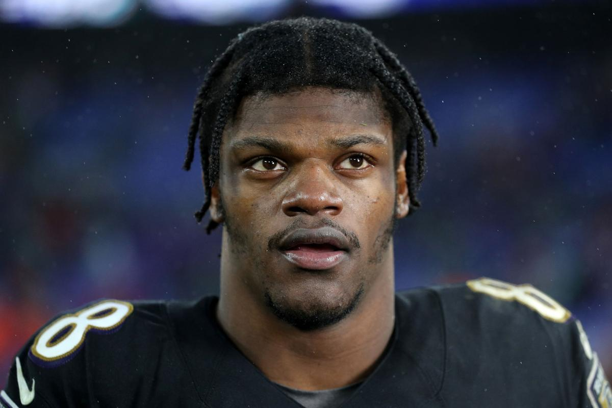 Quarterback Lamar Jackson #8 of the Baltimore Ravens looks on after defeating the San Francisco 49ers at M&T Bank Stadium on Dec. 1, 2019 in Baltimore, Md.