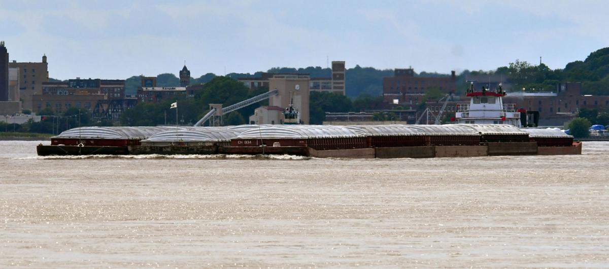 Barge traffic on the Mississippi River in the Quad Cities area.