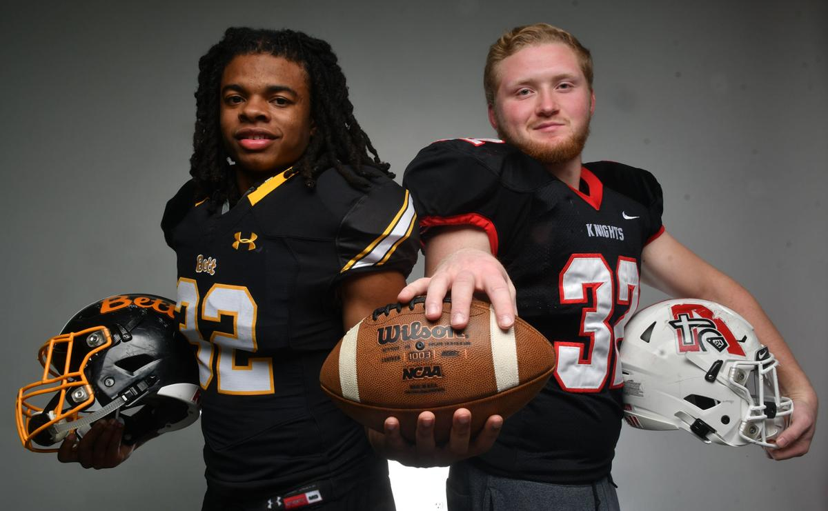 All-Metro football captains Bettendorf's Harrison Bey-Buie and Assumption's Seth Adrian.