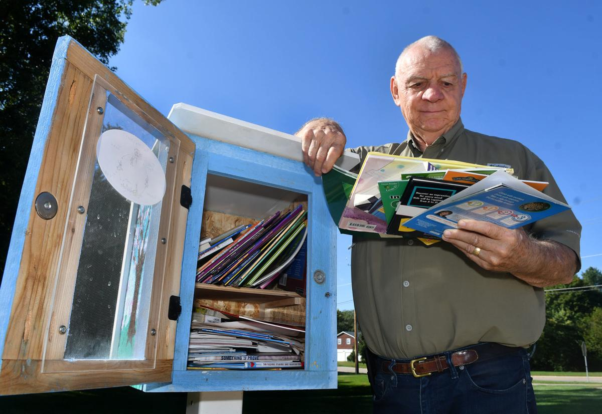 Quad-Citizen of the Year, John Kessler help to build Little Libraries.