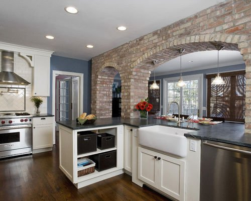 Exposed Brick Arches Become the Star in This Wilmette Kitchen ... on solid surface countertops, hanstone countertops, granite countertops, quartz countertops, bamboo countertops, silestone countertops, obsidian countertops, paperstone countertops, agate countertops, metal countertops, copper countertops, marble countertops, concrete countertops, slate countertops, butcher block countertops, stone countertops, gray limestone countertops, corian countertops, black countertops, kitchen countertops,