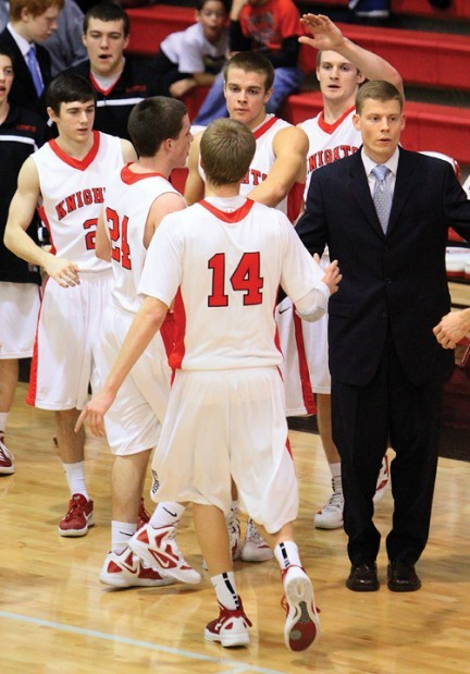 assumption coach joe barrer shakes hands with his players as they come to the bench during a timeout feb 7 john schultz quad city times