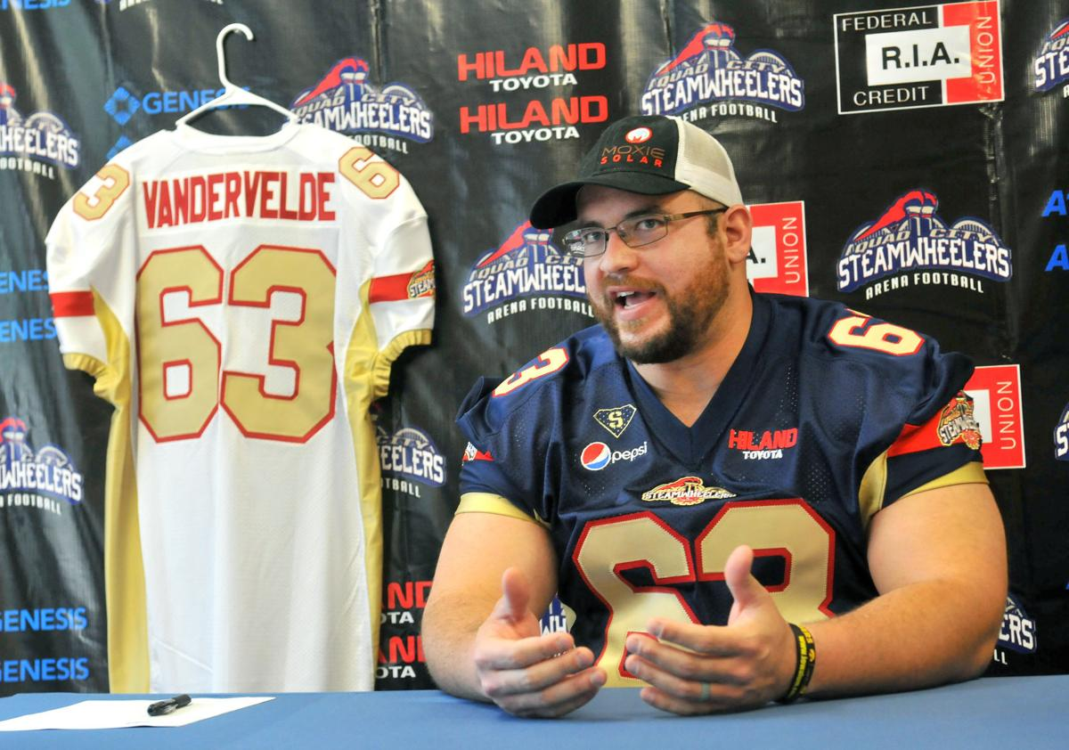 Julian Vandervelde signing with the Quad City Steamwheelers.