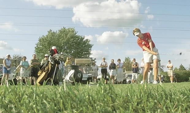LPGA Professional Beth Bader of Eldridge gives some golf pointe