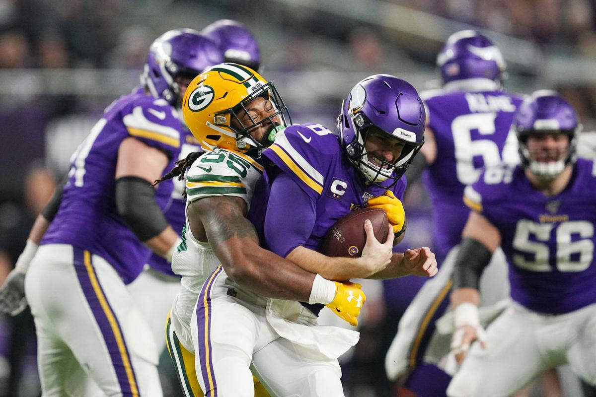 Minnesota Vikings quarterback Kirk Cousins (8) is sacked by Green Bay Packers outside linebacker Za'Darius Smith (55) in the second quarter Monday, Dec. 23, 2019 at U.S. Bank Stadium in Minneapolis, Minn.