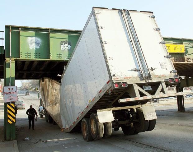 Low Truck Eating Bridge Snares Semitrailers Traffic