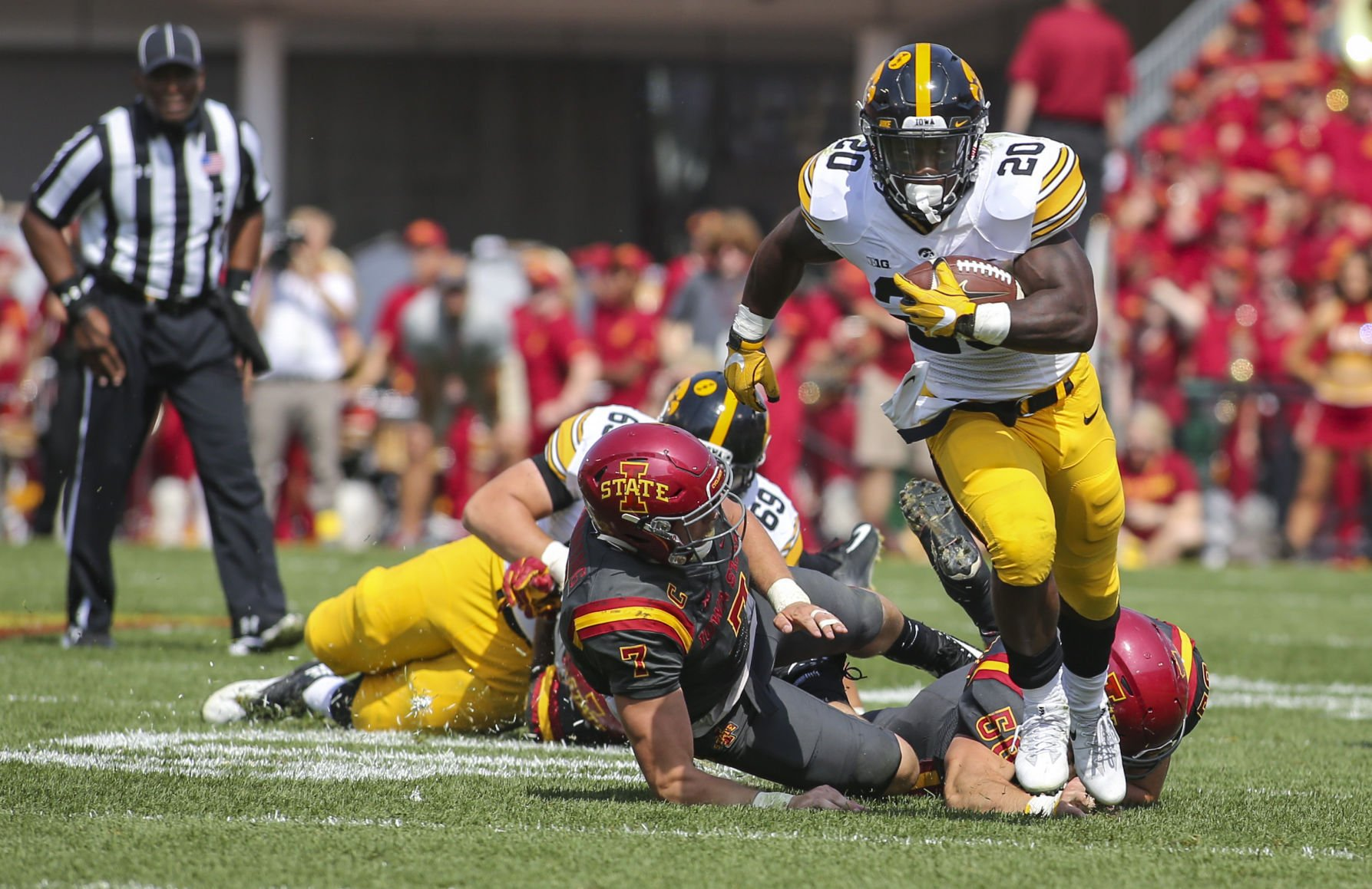 Young running backs spur Iowa past North Texas