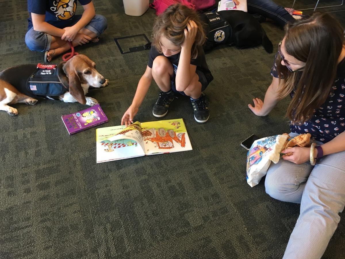 Reading with dog at Eastern Branch, Dav Public Library
