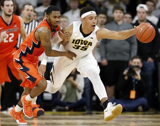 Hill's 21, Lucas block help Illini hold off Iowa 70-66