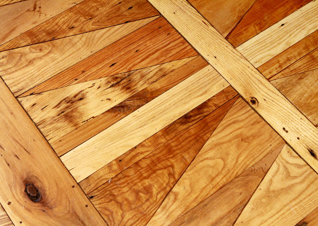 Barn salvage becomes flooring decor at henry county home for Hardwood floors quad cities