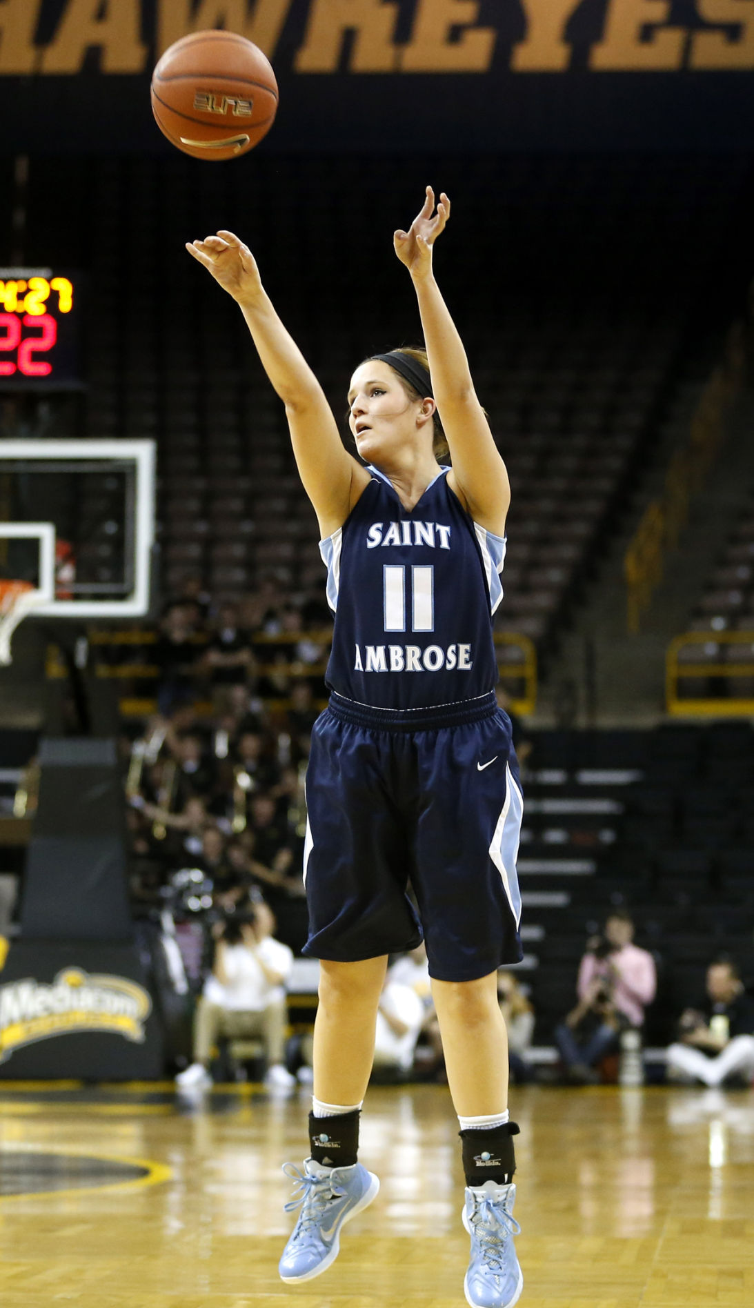 81c5ba03c44d3 Deanna Busse of St. Ambrose shoots during an exhibition game at Iowa during  the 2014-15 season.
