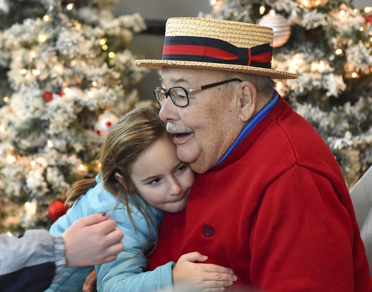 Holiday hugs at annual Happy Joe party