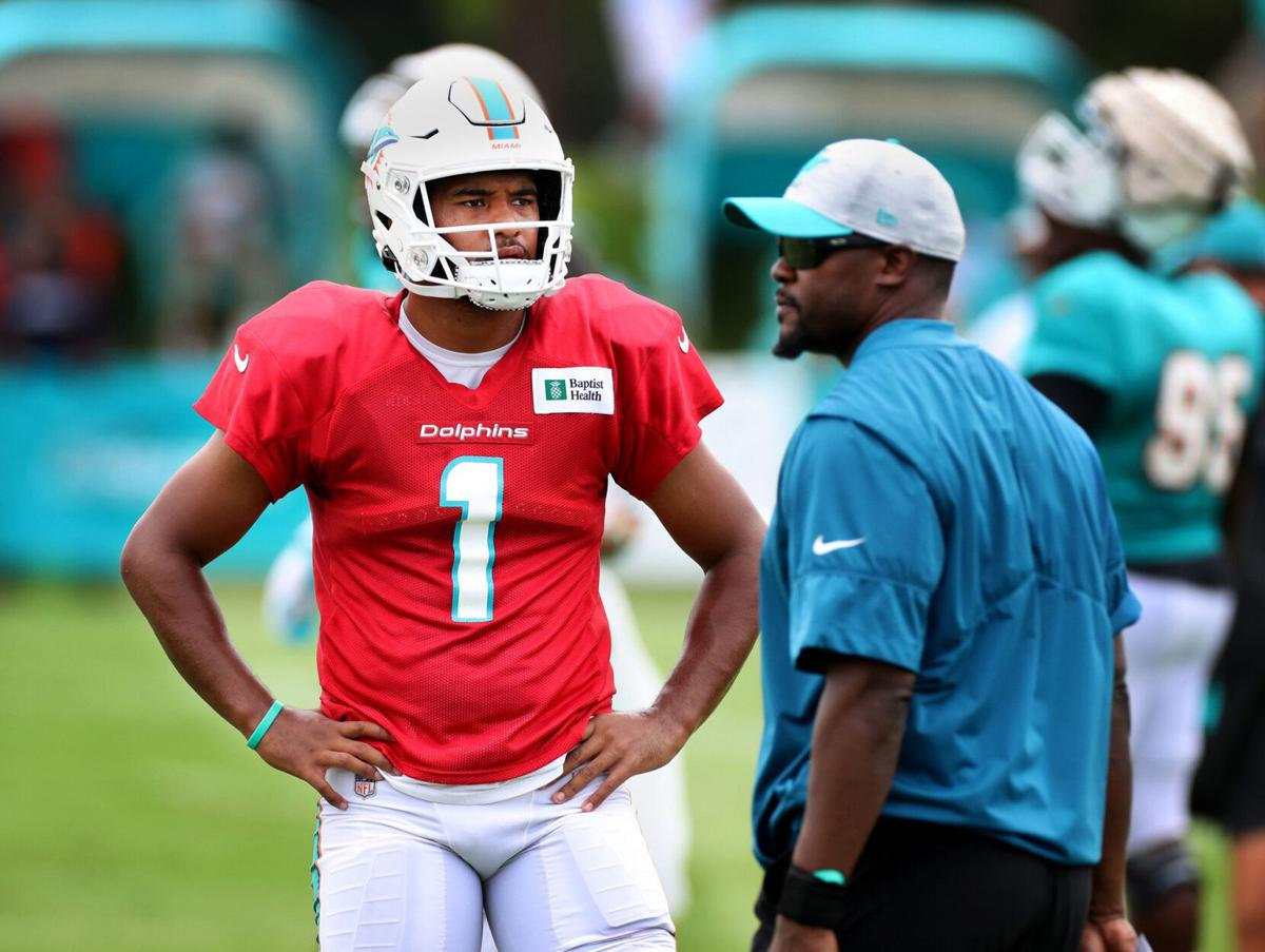 Miami Dolphins quarterback Tua Tagovailoa and Coach Brian Flores during practice at the Baptist Health Training Complex at Hard Rock Stadium on Tuesday August 3, 2021 in Miami Gardens, FL..