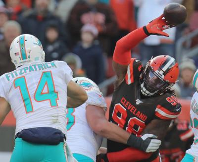Cleveland Browns' Sheldon Richardson swats away a third quarter pass by Miami Dolphins quarterback Ryan Fitzpatrick on Sunday, Nov. 24, 2019 in Cleveland, Ohio, at FirstEnergy Stadium. The Browns won the game 41-24.
