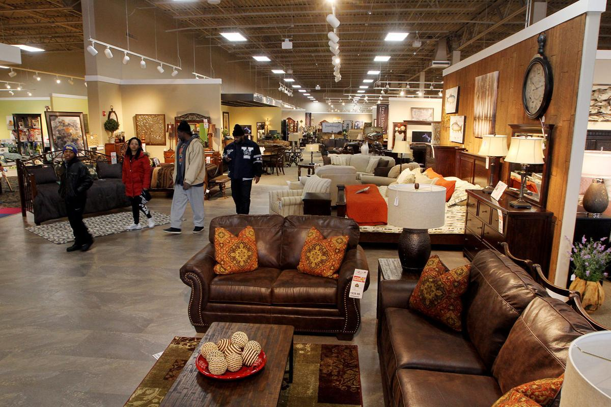 Ashley furniture officially joins elmore avenue retail for Furniture quad cities