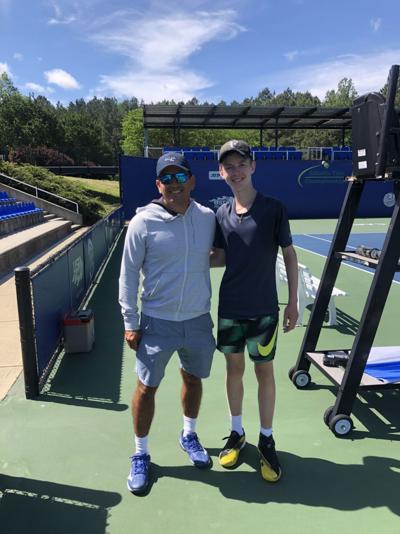 Nicholas Patrick (right) and tennis coach Nestor Nunez