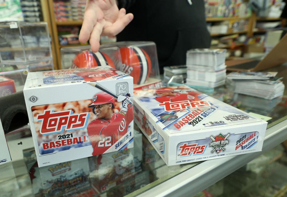 Jim and Steve's Sportscards owner Steve Wilson describes the contents of the 2021 Topps first series baseball cards released on Feb. 10, 2021, in Waukegan.