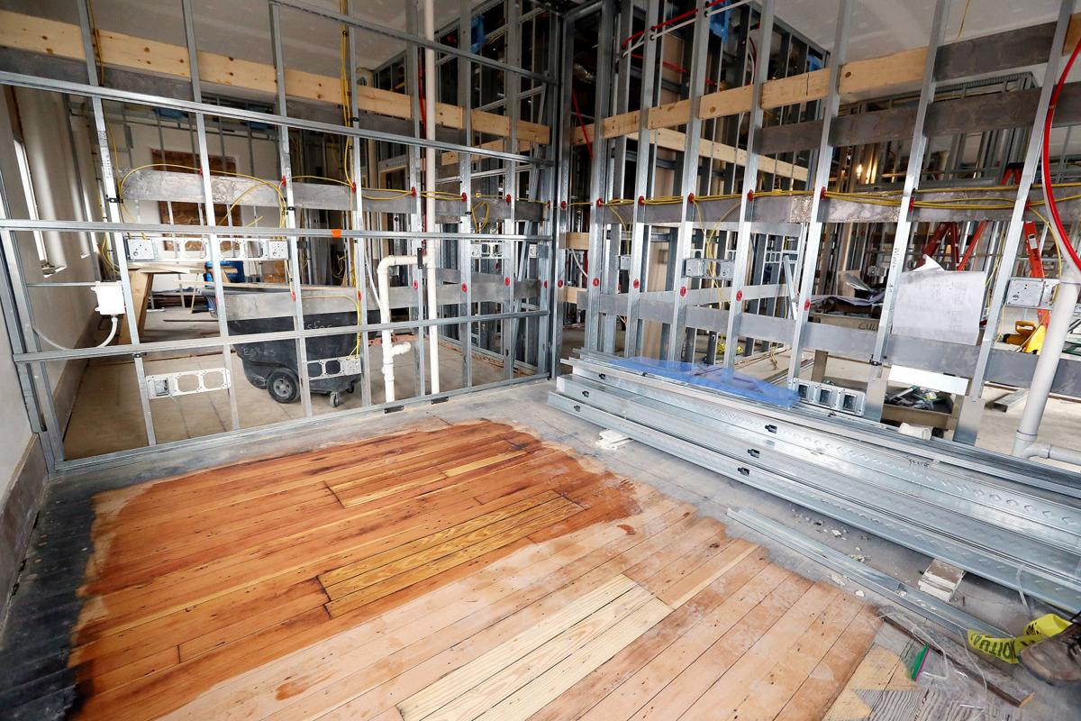 Apartments roof top pool begin to take shape local news for Hardwood floors quad cities