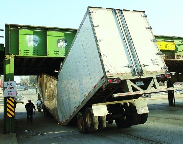Truck hits bridge