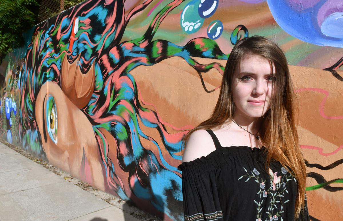 Madelynn Vogt artist of mermaid face on mural at Lincoln Road and 18th Street in Bettendorf.