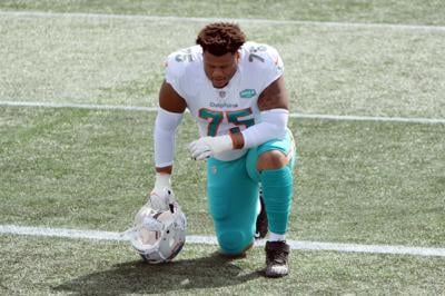 Ereck Flowers #75 of the Miami Dolphins kneels before the game against the New England Patriots at Gillette Stadium on September 13, 2020, in Foxborough, MA.