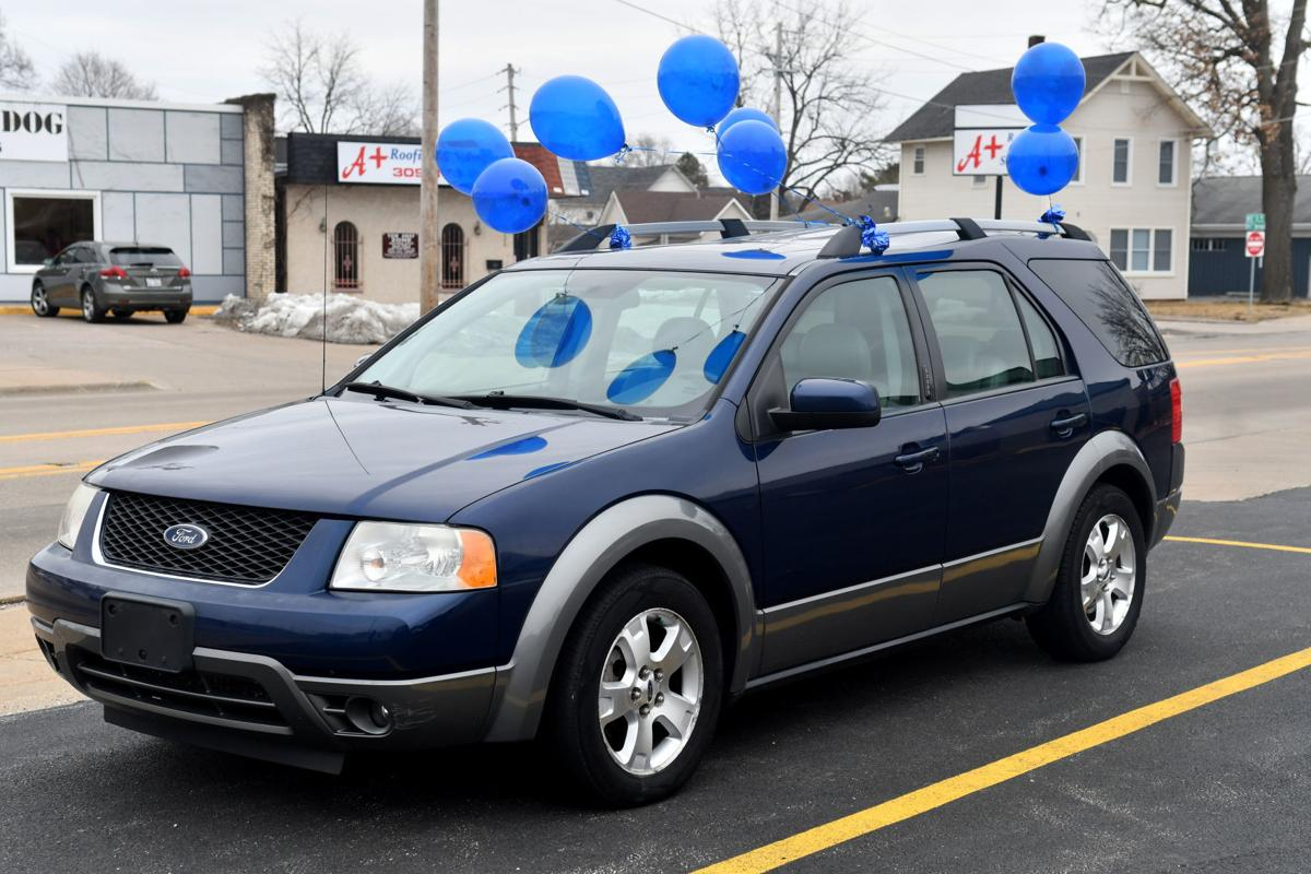 Moline police and Moline Municipal Credit Union give car away