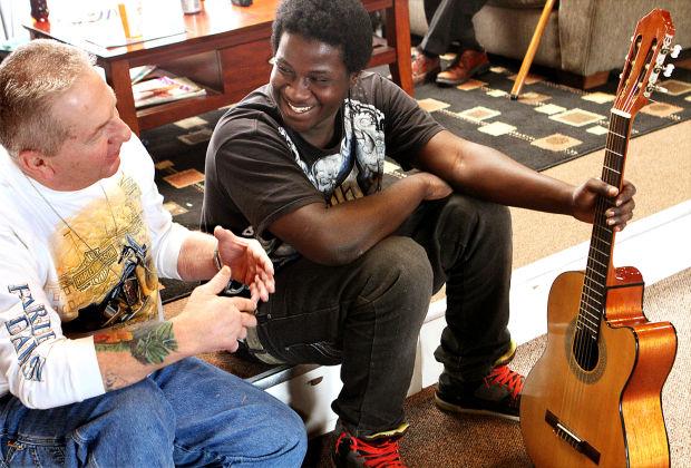 homeless open mic performer gets surprise guitar local news. Black Bedroom Furniture Sets. Home Design Ideas