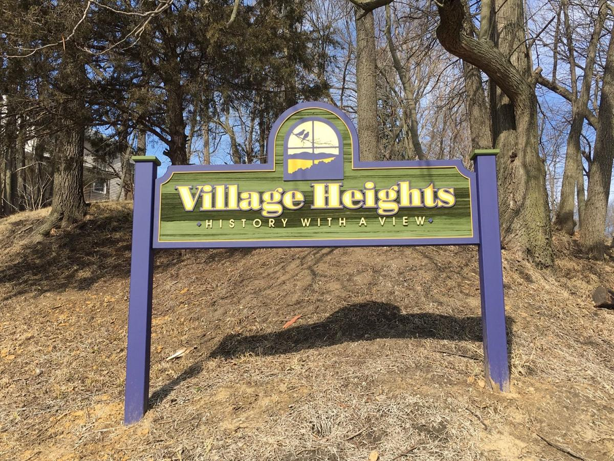 village heights sign