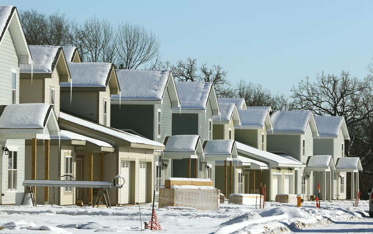 Ickes: New homes rise from Arsenal island | Barb Ickes