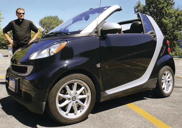 The Rev Rich Adam Pastor Of Sacred Heart Cathedral In Davenport Says His New Smart Car Runs On A Three Cylinder Engine And Gets 45 Miles Per Gallon