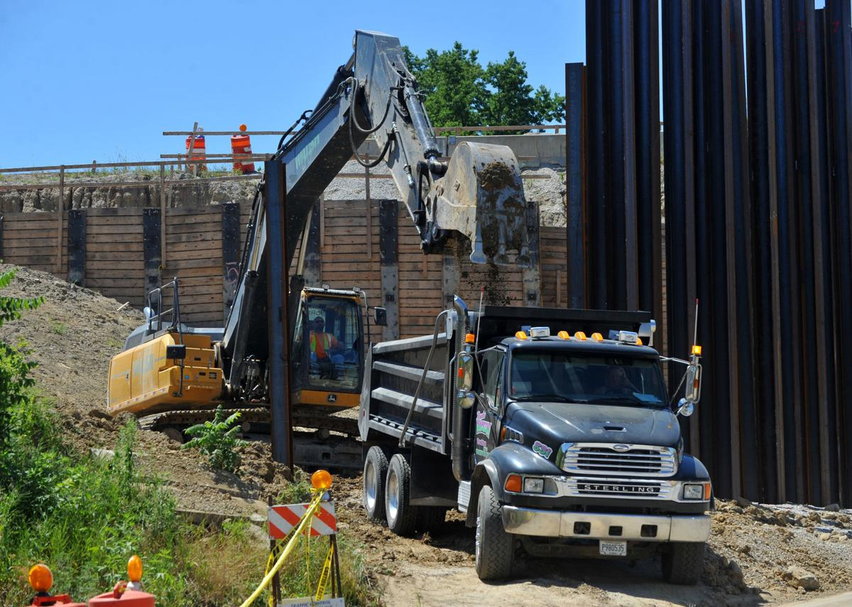 Dump truck hauling for I-74 bridge project.